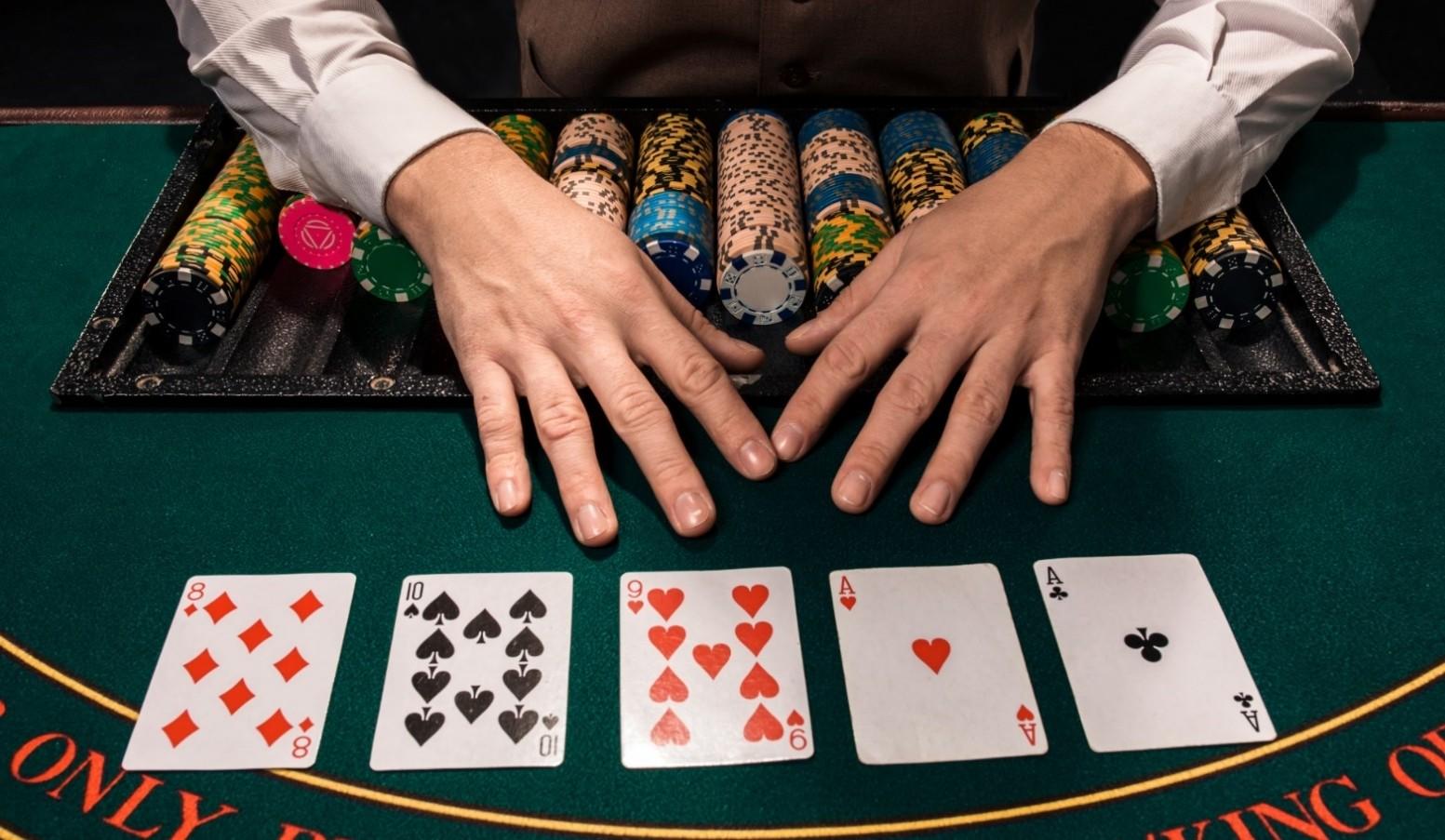 dealer hands on a poker table