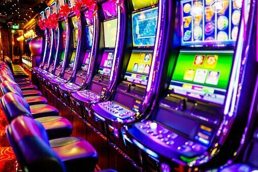 Line of electronic slot machines in casino. Property released.