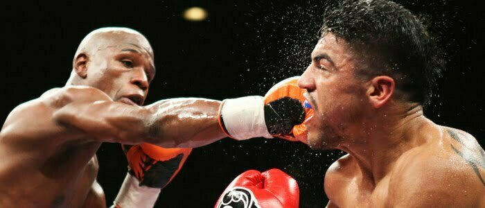 Mayweather Jr. of the U.S. battles it out with WBC welterweight champion compatriot Ortiz during their title fight at the MGM Grand Garden Arena in Las Vegas