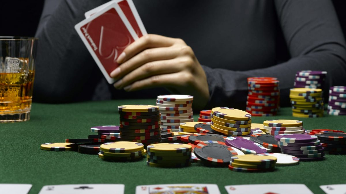poker table with cards and chips on it
