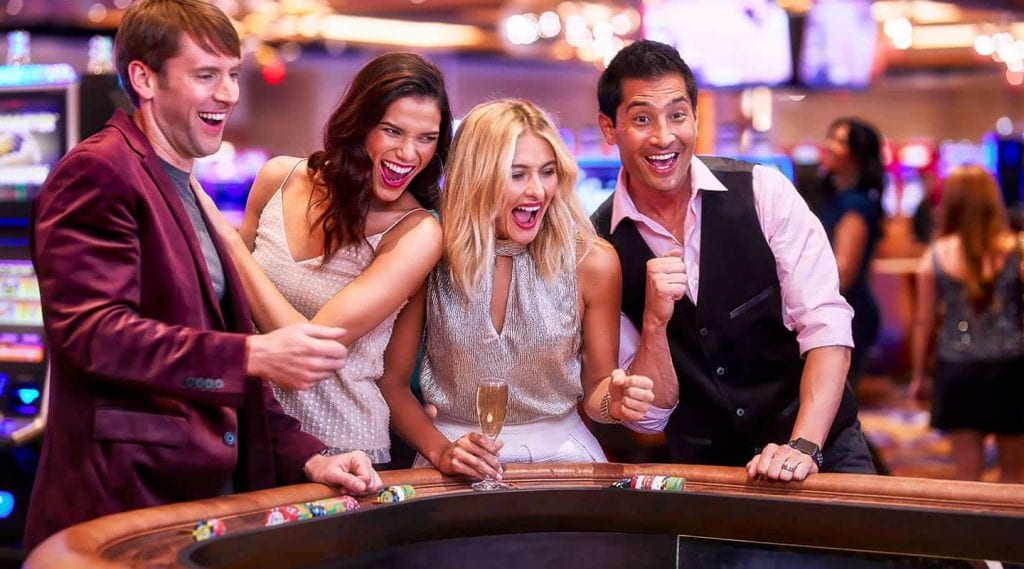happy people around a casino table