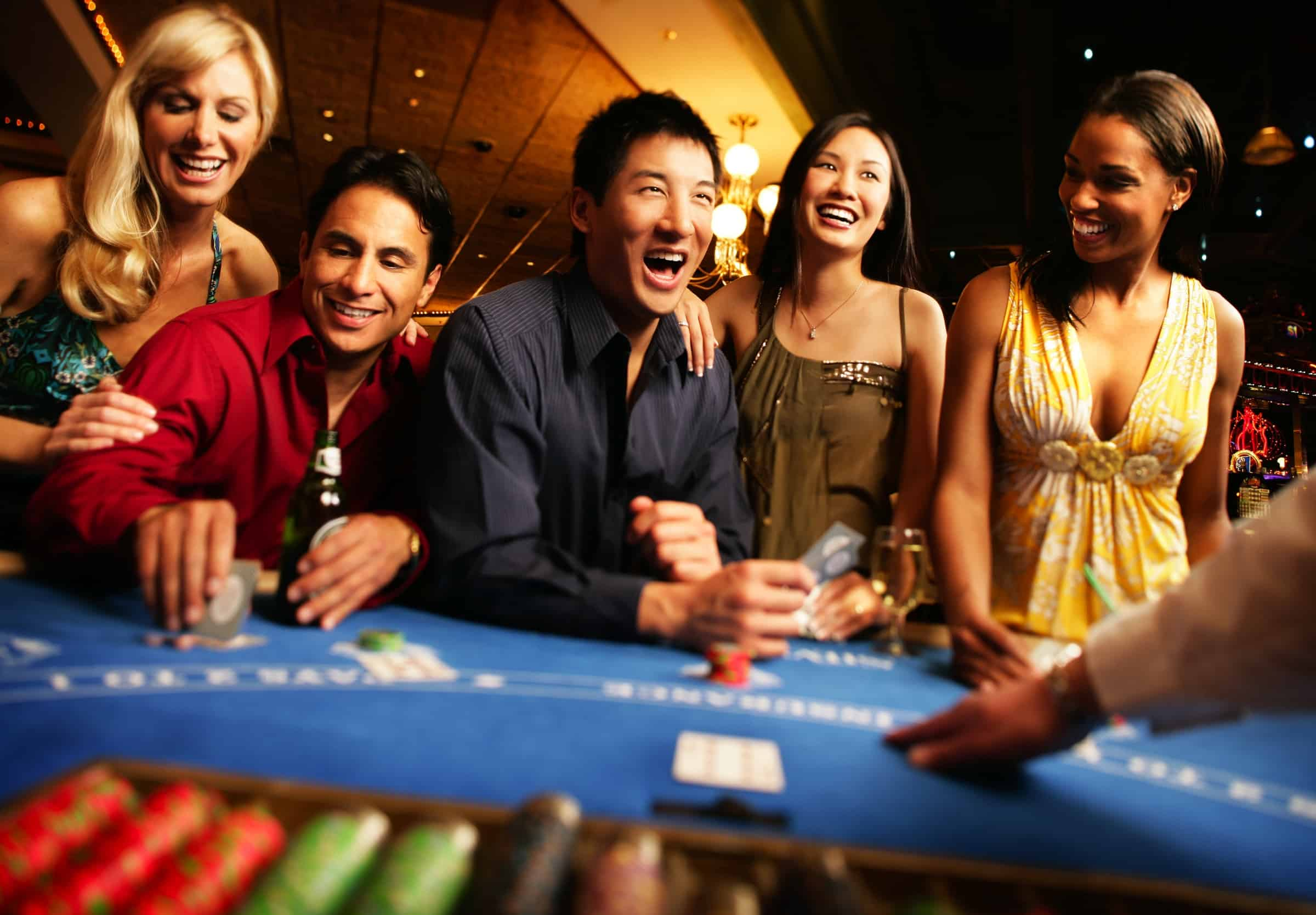 a group of people enjoying a casino night