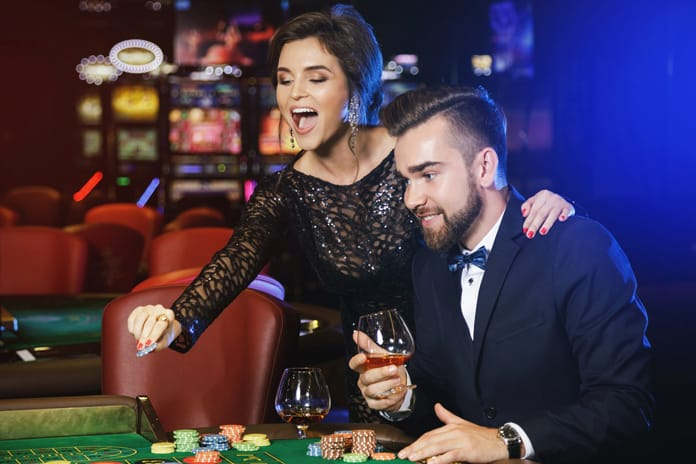a man and woman smiling in a casino room