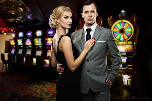 a couple standing next to each other in a casino room